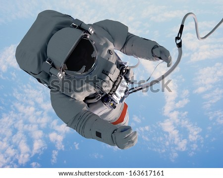 """Astronaut in space above the clouds of the Earth..""""Elemen  ts of this image furnished by NASA"""" - stock photo"""