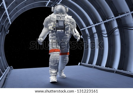 "Astronaut in the tunnels of the spacecraft. ""Elements of this image furnished by NASA"" - stock photo"