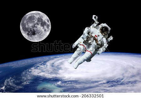 Astronaut moon Earth space world background. Elements of this image furnished by NASA. - stock photo