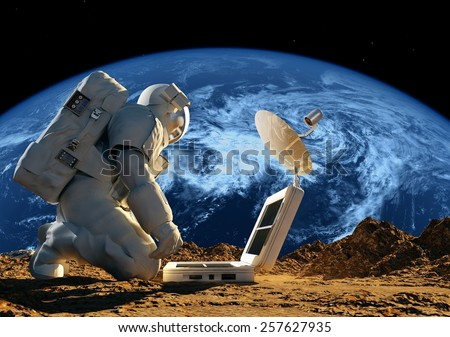"Astronaut on his knees near the solar battery. ""Elemen ts of this image furnished by NASA"" - stock photo"