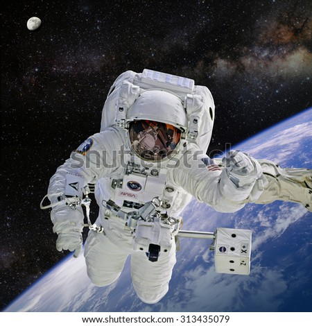 Astronaut on space mission. Elements of this image furnished by NASA.
