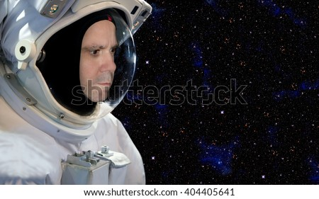 Astronaut on space mission with stars on the background - stock photo