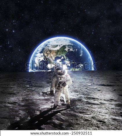 Astronaut on the Moon - Elements of this Image Furnished by NASA - stock photo