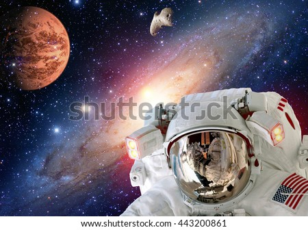 Astronaut planet Mars spaceman helmet man space suit extraterrestrial martian colony. Elements of this image furnished by NASA. - stock photo