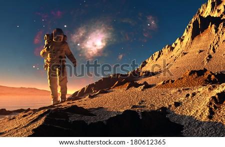 Astronaut runs on background of mountain lanshafty. - stock photo