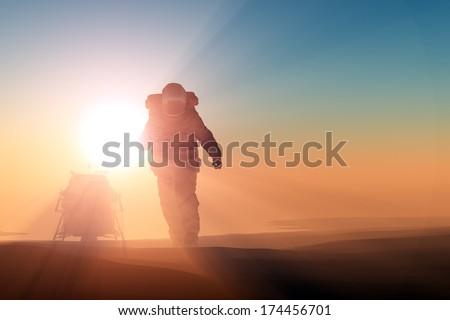 Astronaut runs on the planet. - stock photo