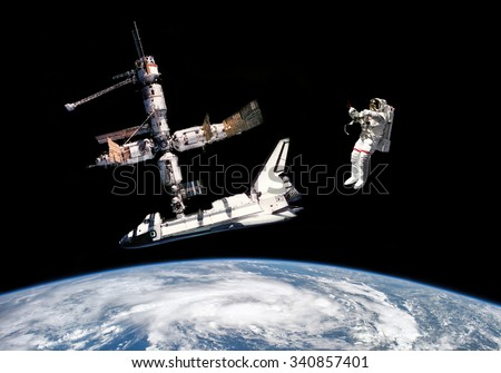 Astronaut, space shuttle and space station - Elements of this image furnished by NASA - stock photo