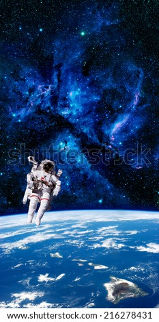 Astronaut spaceman aerial space stars Earth. Elements of this image furnished by NASA. - stock photo