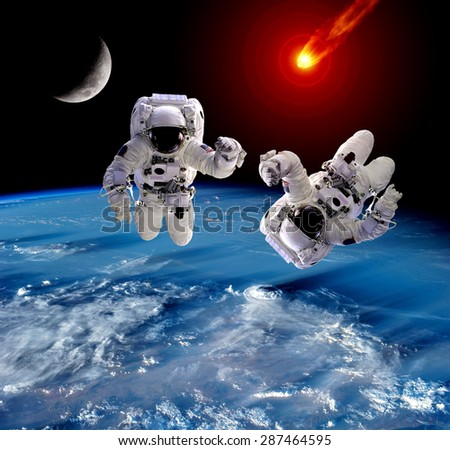 Astronaut spaceman Earth meteor asteroid meteorite moon. Elements of this image furnished by NASA. - stock photo