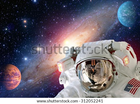 Astronaut spaceman helmet outer space solar system planet universe. Elements of this image furnished by NASA. - stock photo