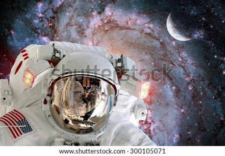 Astronaut spaceman helmet outer space station satellite galaxy moon. Elements of this image furnished by NASA. - stock photo