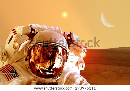 Astronaut spaceman helmet space planet Mars apocalypse moon. Elements of this image furnished by NASA. - stock photo