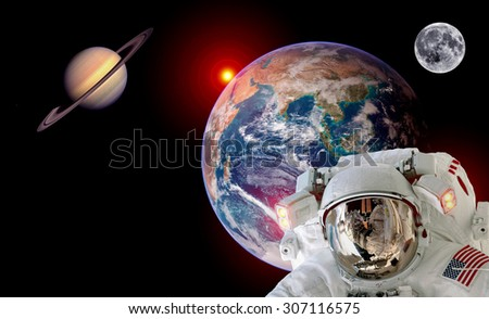 Astronaut spaceman isolated helmet outer space earth sun saturn planet moon. Elements of this image furnished by NASA. - stock photo