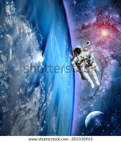 Astronaut spaceman outer space moon earth astronomy astrology. Elements of this image furnished by NASA. - stock photo
