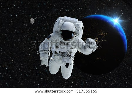 Astronaut spaceman outer space people planet earth moon. Beautiful blue sunrise. Elements of this image furnished by NASA.  - stock photo