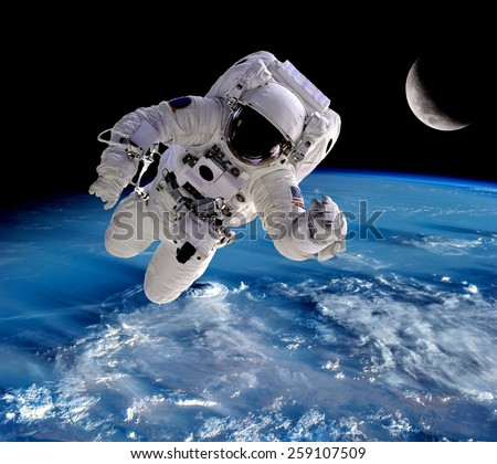 Astronaut spaceman outer space people planet earth moon. Elements of this image furnished by NASA. - stock photo
