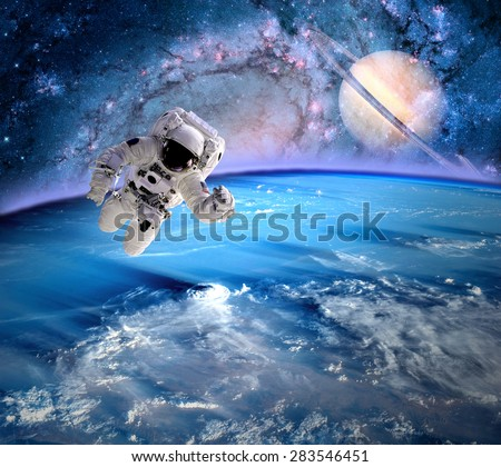 Astronaut spaceman outer space saturn planet solar system universe. Elements of this image furnished by NASA.