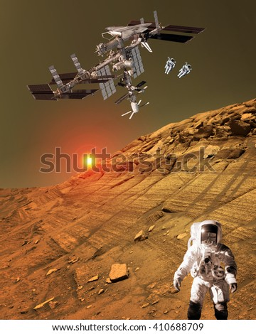 Astronaut spaceman planet Mars surface martian colony space landscape. Elements of this image furnished by NASA. - stock photo