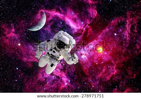 Astronaut spaceman suit outer space moon sun universe. Elements of this image furnished by NASA. - stock photo