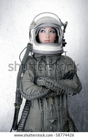 astronaut spaceship aircraft helmet fashion woman silver background - stock photo
