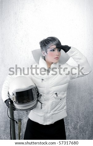 astronaut spaceship driver aircraft helmet fashion woman over silver - stock photo