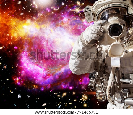 Astronaut with a camera makes a photo. The elements of this image furnished by NASA.
