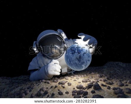"Astronaut with a planet in her hand.""Elemen ts of this image furnished by NASA"" - stock photo"