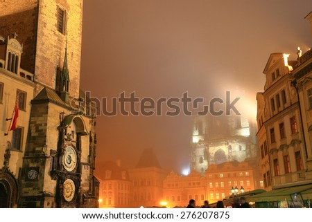 Astronomical Clock on the Old Town all wall illuminated in foggy night, Prague old town, Czech Republic - stock photo