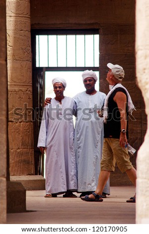 ASWAN - APRIL 29:Visitors in Temple of Philae on April 29 2007 near Aswan, Egypt. The number of tourists visiting Egypt dropped by more than a third since the Egyptian revolution on Jan 25 2011.