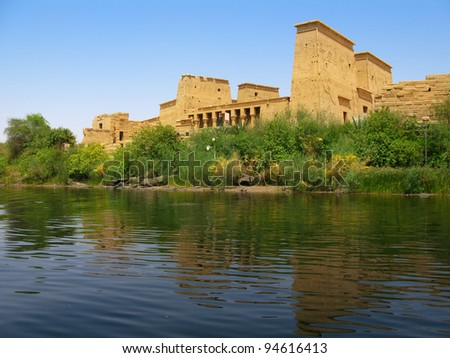 Aswan, Egypt: The amazing Temple of Isis at Philae island in Lake Nasser, seen from a boat. Located at 11 km of Aswan, Egypt - stock photo