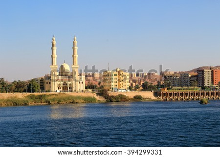 Aswan Mosque along the Nile River with two minarets - stock photo