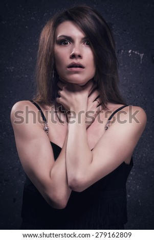 Asylum. Lonely crazy woman chocked herself. Low key. - stock photo