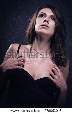 Asylum. Lonely crazy woman. Low key. - stock photo