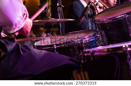 At a concert musician playing his instrument