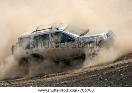 At a 4x4 event, an offroader naviagtes in deep dust and sand. South of Lima, Peru. - stock photo