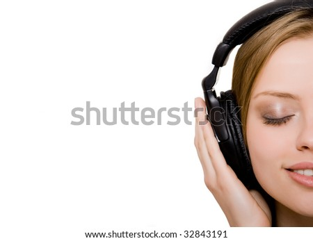 at attractive girl with headphones