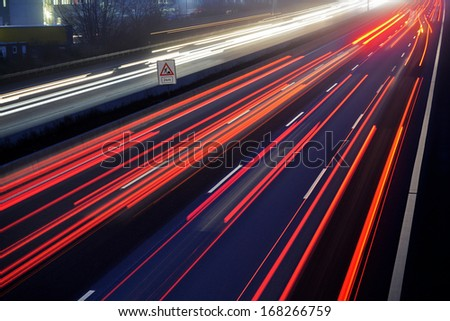 at dusk long time exposure of traffic car lights on motorway  - stock photo