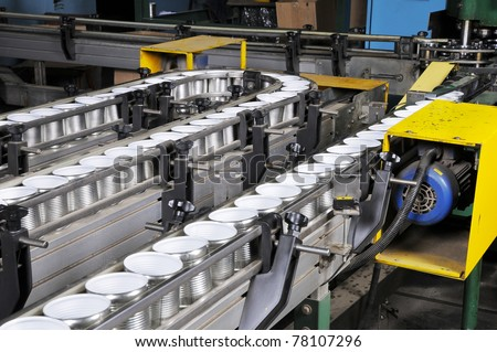 At factory on manufacturing of tins and covers. - stock photo