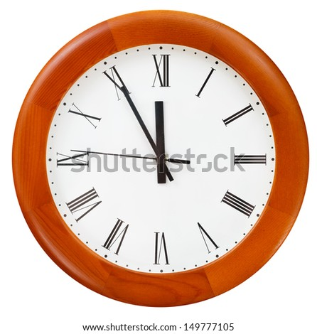 at five minutes to twelve o clock on round dial clock - stock photo