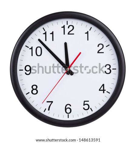 At five to twelve o'clock on the dial round clock - stock photo