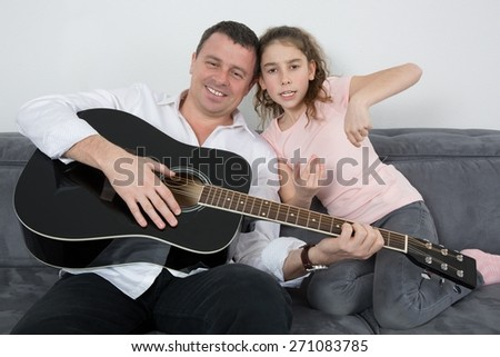 At home father and his daughter - stock photo