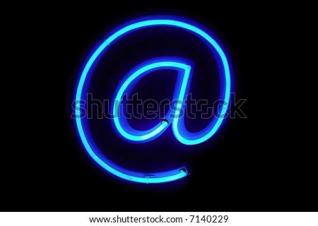 At neon sign at night - stock photo