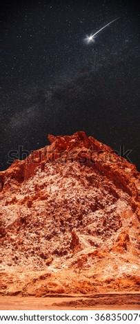 At night, under the light of stars. Valle de la Luna (Moon Valley) close to San Pedro de Atacama, Chile - stock photo
