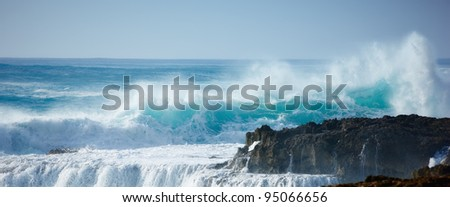 At photo of wild waves, stormy weather and rocks - Oahu, Hawaii - stock photo