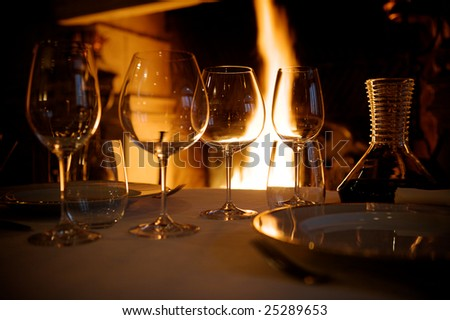 at restaurant warm ambience glasses and wines - stock photo