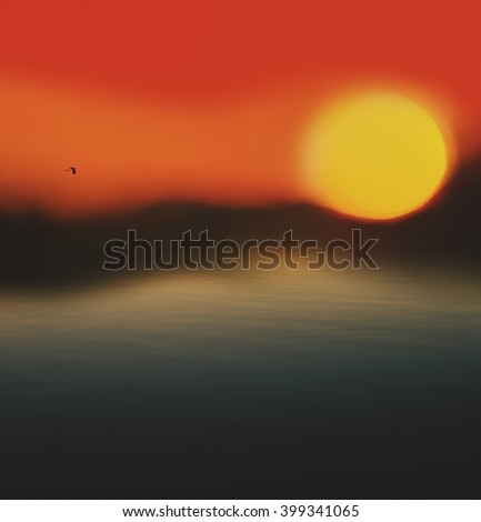 At sunset rises from the horizon haze. The whimsical look of the disc of the sun and distant shore. - stock photo