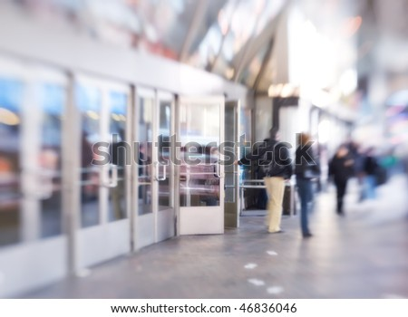 At the airport - lens and motion blurred business people - stock photo