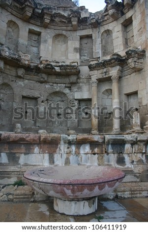 At the ancient ruined city of Gerash in Jordan this marble fountain was built to honor Alexander the Great and the niches once held statues - stock photo