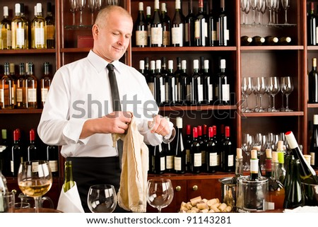 At the bar - waiter clean glass with dish clove  restaurant - stock photo
