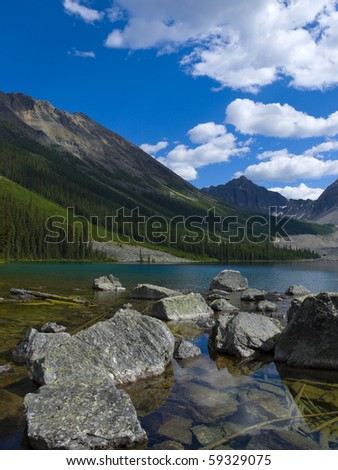 "At the end of a hiking trail you'll find ""Consolation Lake"" in Banff Natinal Park, Alberta, Canada - stock photo"